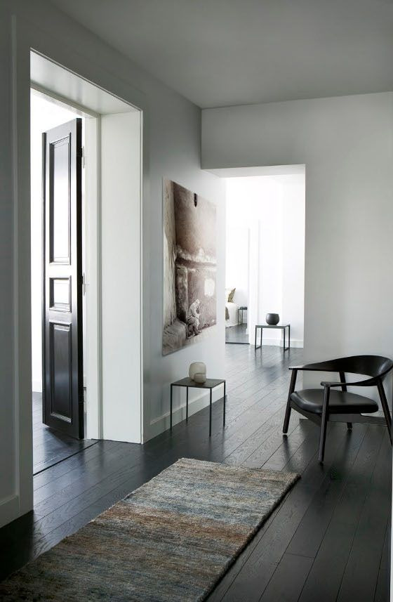 black doors and flooring, white walls