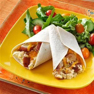 Breakfast Burrito Recipes - In the mood for a breakfast burrito? Simple, delicious and fit for a family breakfast or fancier brunch, add a little fun to your table with these savory breakfast bundles.