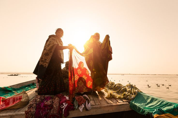 Morning Washing - Women doing the laundry at dawn in the River Ganges in…