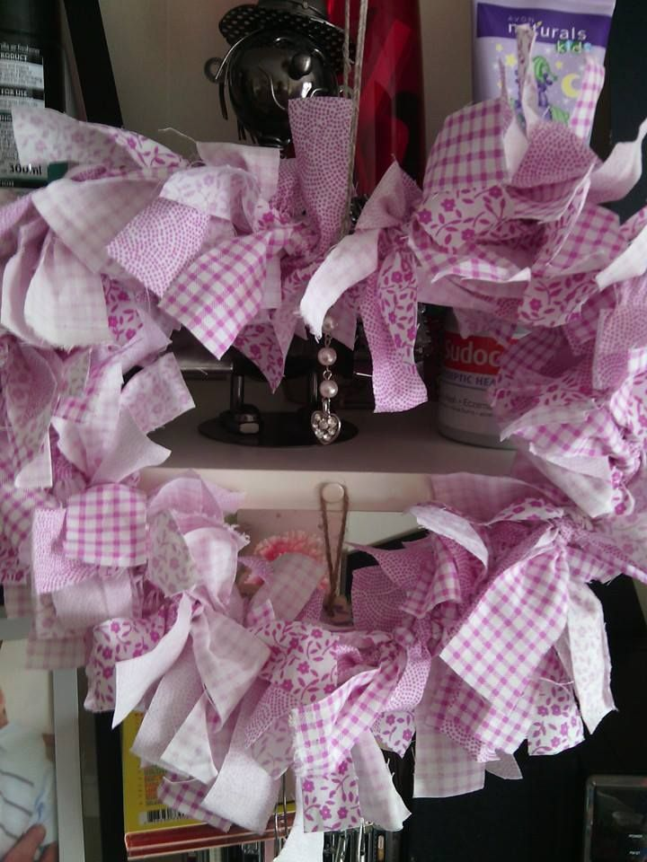 Pink rag wreath with a hanging heart in the middle