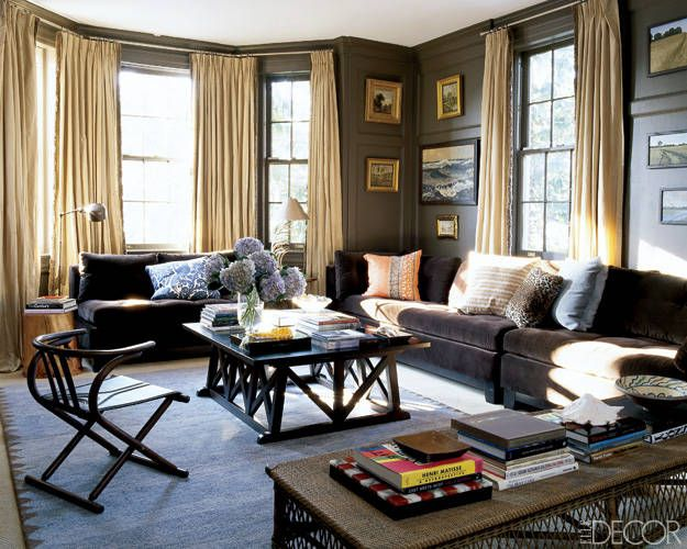 Sofas and a wool rug from ABC Carpet & Home warm up this family room.