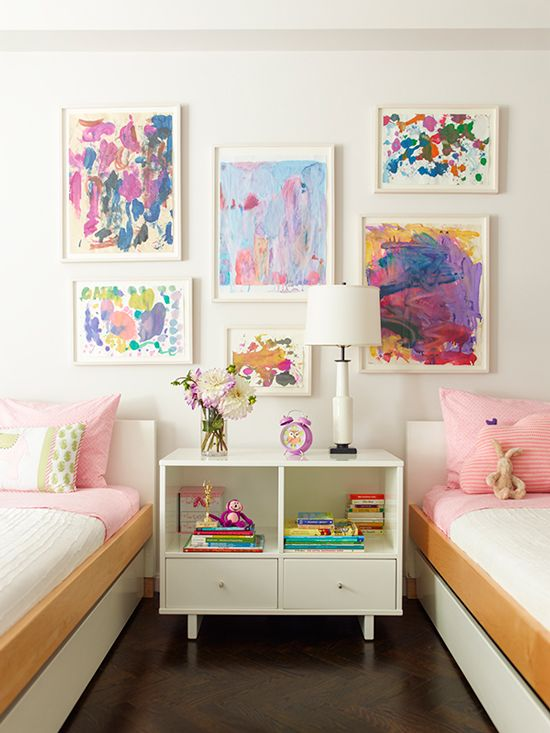 This bedroom is decorated with kid-created art.