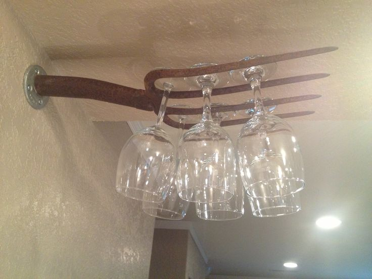 Homemade Vintage pitchfork wine glass holder.
