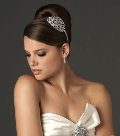 Updo bun with a silver sparkling decoration #hot #sexy #hairstyles #hairstyle #hair #long #short #medium #buns #bun #updo #braids #bang #greek #braided #blond #asian #wedding #style #modern #haircut #bridal #mullet #funky #curly #formal #sedu #bride #beach #celebrity #simple #black #trend #bob #girls