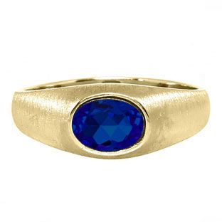 East-West Oval Cut Sapphire Yellow Gold Pinky Ring For Men Gemologica.com offers a unique selection of mens gemstone and birthstone rings crafted in sterling silver and 10K, 14K and 18K yellow, white and rose gold. We have cool styles including wedding and engagement rings, fashion rings, designer rings, simple stone and promise rings. Our complete jewelry collection of gemstone rings for men can be seen here: www.gemologica.com/mens-gemstone-rings-c-28_46_64.html