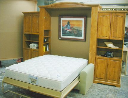 This SICO queen Euro Bed (open) went to Sarasota, Florida. The finish is a golden teak on Knotty Pine. Customer sent lime colored fabric to match rooms decor. flyingbeds.com