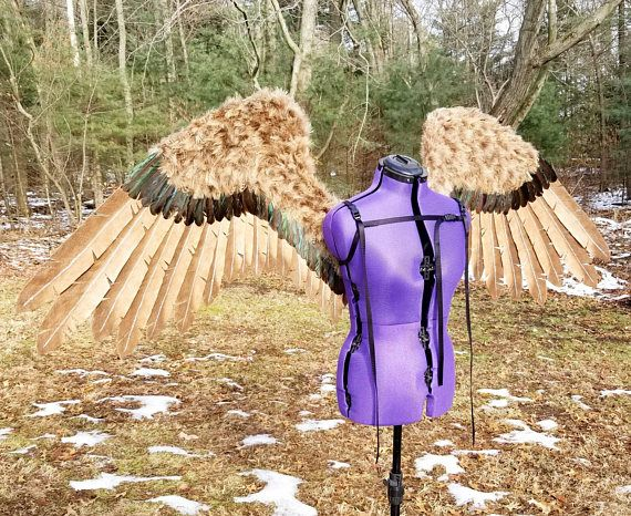 Take to the skies of your imagination in these beautiful Hawkman inspired cosplay wings. Each giant felt flight feather has been stiffened and airbrushed by hand for added detail. The secondary feathers add a touch of contrast with their dark shade of brown and hint of natural green