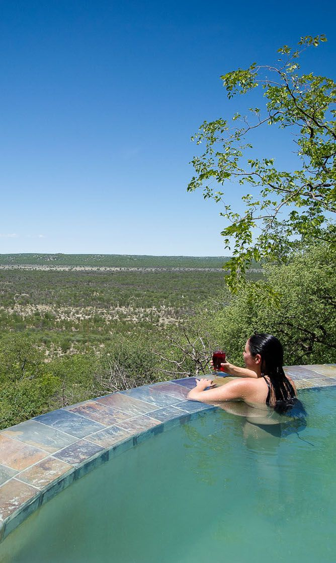 Little Ongava Lodge in Namibia is an ultra exclusive safari lodge in a productive private reserve bordering Etosha Park. Sit in the infinity pool and gaze into utter wilderness. Timbuktu Travel.