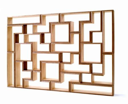 Hubby and I plan on creating tetris shelves for our library. We will make sure there is at least one open spot in each row. We also plan on adding backs.
