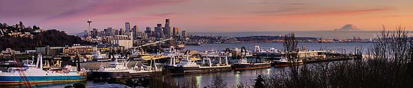 Wide photo of the Seattle skyline from Magnolia Bridge at dusk.