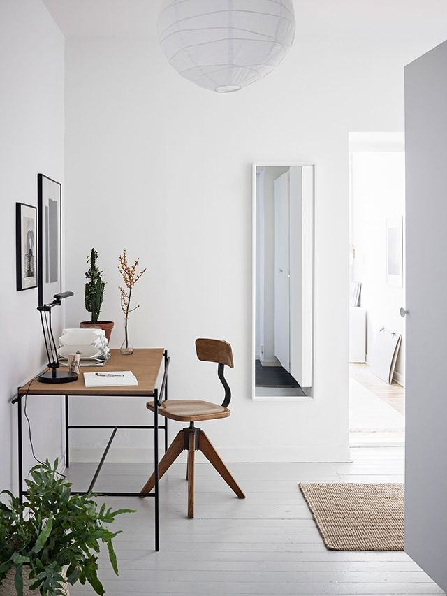 Warm and inviting, this home's interior provides a lesson on how to stylishly mix old and new. Vintage furniture and lighting sit alongside...