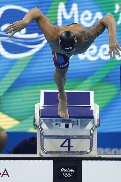 USA's Caeleb Dressel competes in the Men's 100m Freestyle Semifinal during the swimming event at the Rio 2016 Olympic Games at the Olympic Aquatics Stadium in Rio de Janeiro on August 9, 2016.   / AFP / Odd Andersen