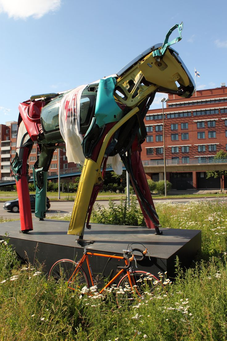 Big colorful cows, made out of thrashed cars, by Miina Äkkijyrkkä