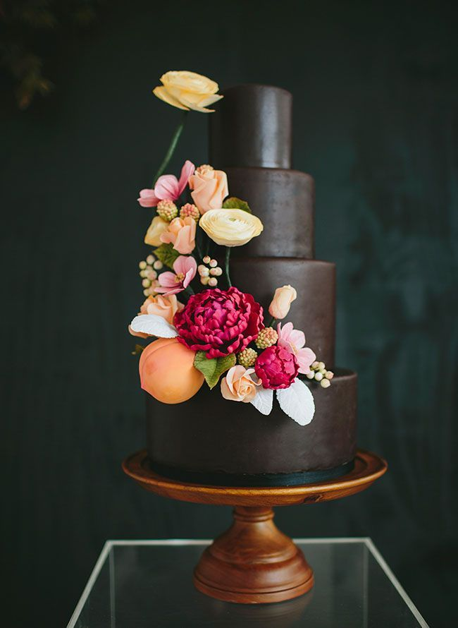 This chocolate covered cake is perfect for autumn thanks not only to its dark hue, but the enchanting seasonal blooms covering it as well.  If you have brown/pink color theme and have set a date for the fall then this might be the cake for you!