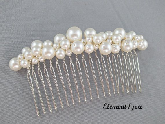 Bridal comb pearl Hair Accessories Wedding hair piece Swarovski white or ivory pearls Beaded silver comb Veil attachment Tiara Fascinator. $26.00, via Etsy.