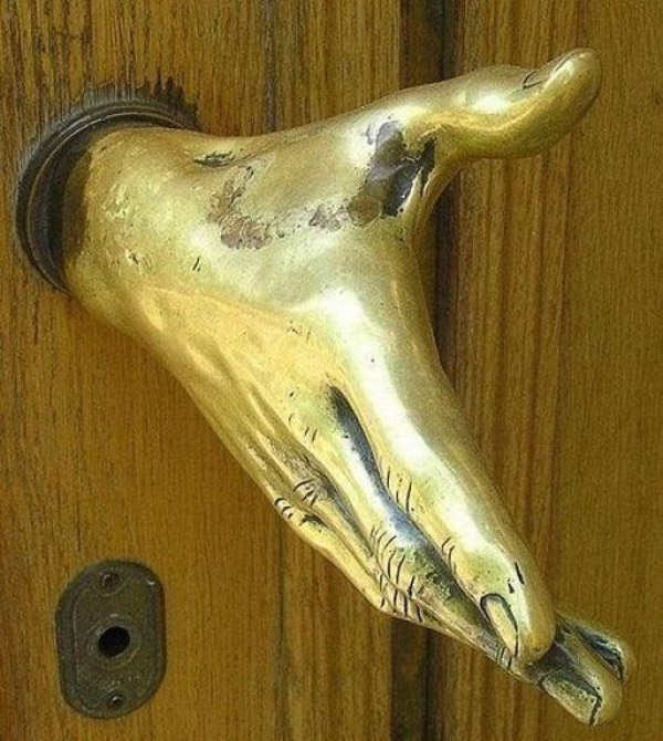 This is a door handle. Neat and creepy all at once.