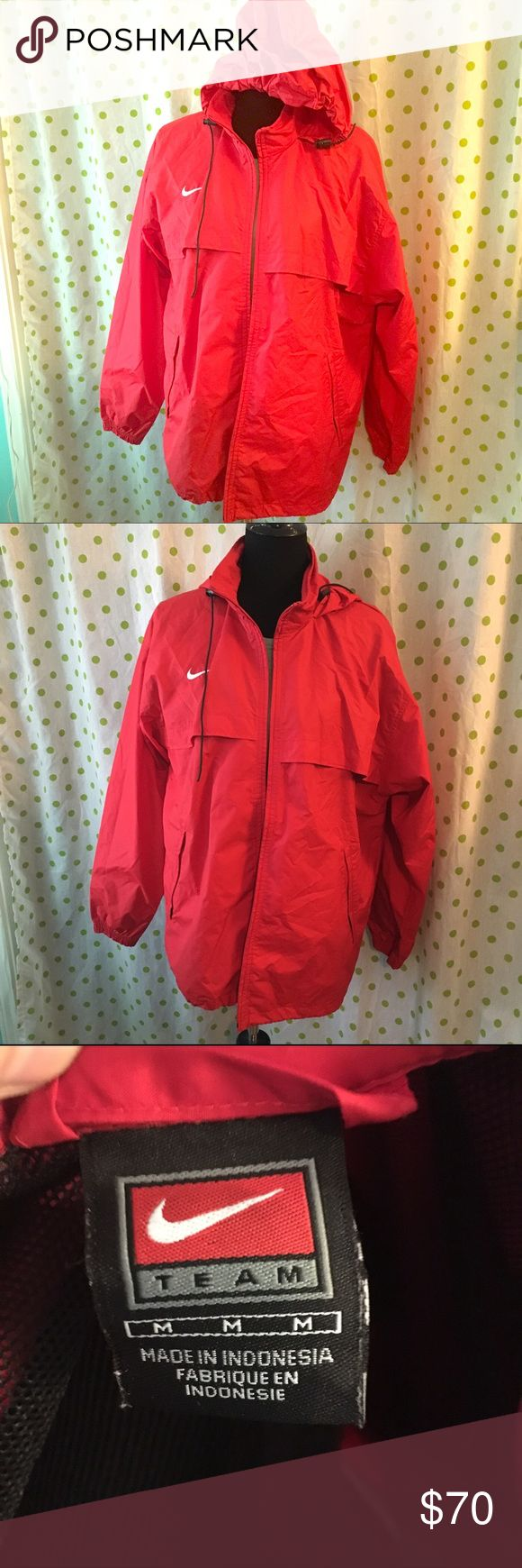 Best Price: Red Nike Rain Jacket This may be a men's jacket, not sure, but it is a size medium, fits oversized, so great for layering. Excellent condition! I would say it could fit medium to possibly XL. Pockets, hood, zips up, red color with white nike swoosh. Nike Jackets & Coats