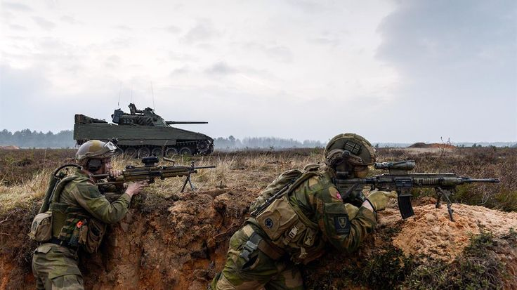 Soldiers and a CV-90 ''Storm tank'' from the Telemark Batallion mechanised infantry unit in the Norwegian Army during exercise in Lativa [1158x651]