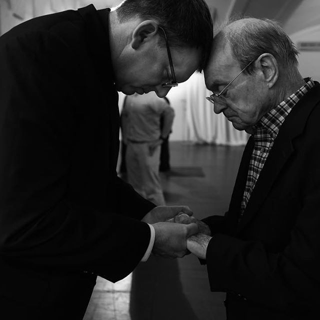 Paulist Fr. John Kenny (right) receiving a first priestly blessing from Paulist Fr. Steven Petroff (left) on May 20, 2017, in the social hall of the Church of St. Paul the Apostle in New York City.