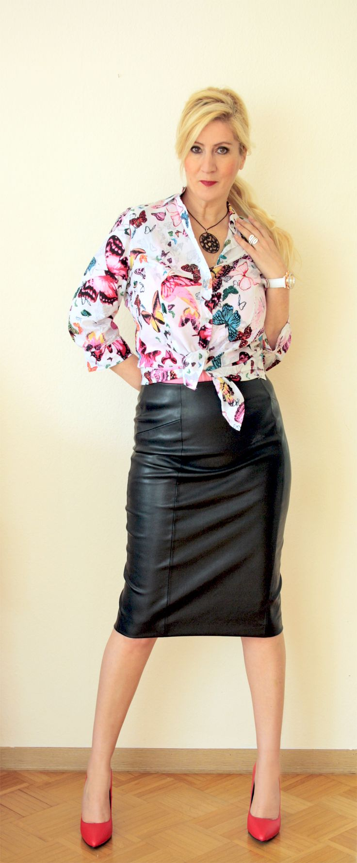black skirt, butterflies blouse