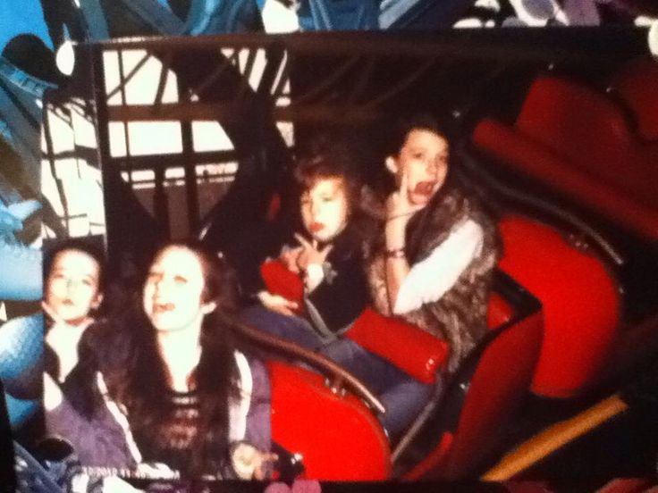 My weird brother, George, and sisters, Jessie and Erin on a ride at galaxy land in West Edmonton Mall, Canada