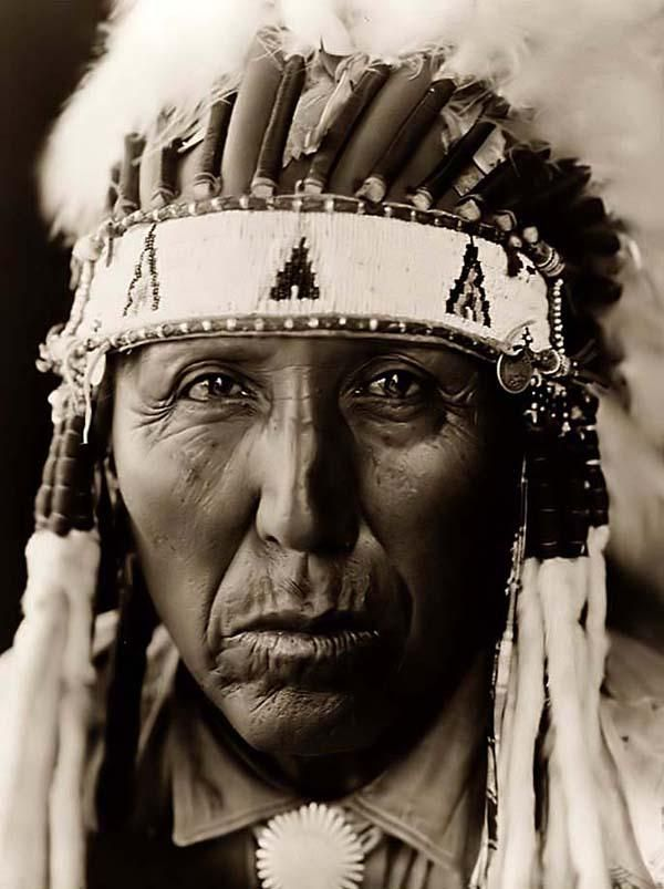 Here we present a dramatic image of Red Bird, a Cheyenne Indian Warrior. It was taken in 1927 by Edward S. Curtis.    The image shows Red Bird, a Cheyenne man in full Feather War Bonnet.    We have created this collection of images primarily to serve as an easy to access educational tool. Contact curator@old-picture.com.    Image ID# 89318454
