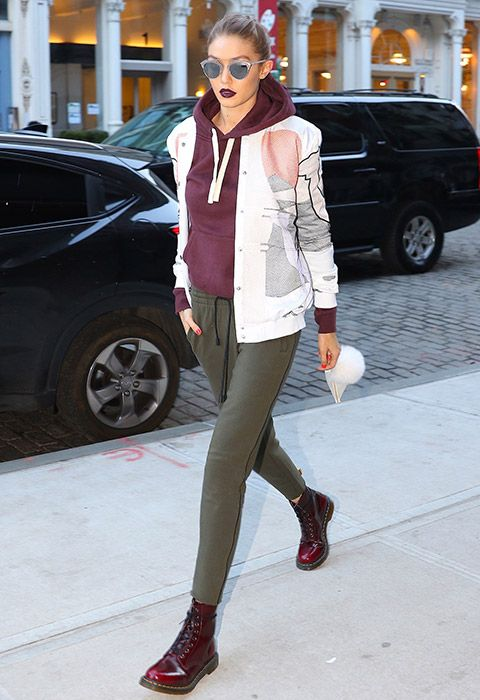 Thanks to Gigi Hadid, the revival of 00s cherry Dr. Martens is here. Sponsor your walk down memory lane with a matchy burgundy hoodie and badass merlot lips, broken up by khaki joggers and a statement bomber jacket