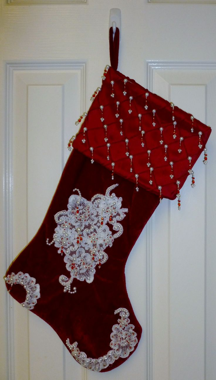 Hand Beaded lace embellished Christmas Stocking. I make these using lace from Vintage Wedding Gowns and embellish them with seed beads, pearls and Swarovski Crystals. These made nice gifts for my family and friends this year.