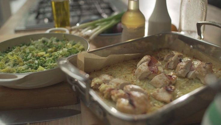 Oven baked rosti with ham and cheese stuffed chicken and peas a la Français