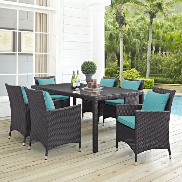 The Gather synthetic rattan outdoor dining set will look lovely in your contemporary outdoor living space. The patio dining set includes a rectangle dining table and six armchairs with all-weather fab