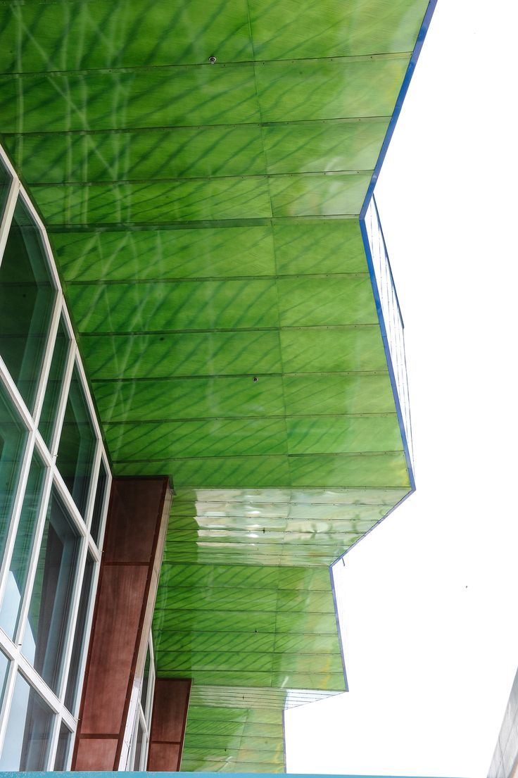 Bold green exterior panels at the Aruba Airport ... #Móz #Moz #Metal #Metals #Metallic #Metallics #Design #Designs #Designer #Surface #Surfacing #Architecture #Architectural #Modern #Contemporary #Decor #Decorative #Material #Materials #Cover #Covering #Art #Interior #Exterior #Aluminum #Neutral #Handcrafted #Color #Laminate #Building #Room #Commercial #Construction #Urban #Bold #Inspiration #Manufacturing #Manufacturer #Green #Greens #Airport #Airports #Aruba