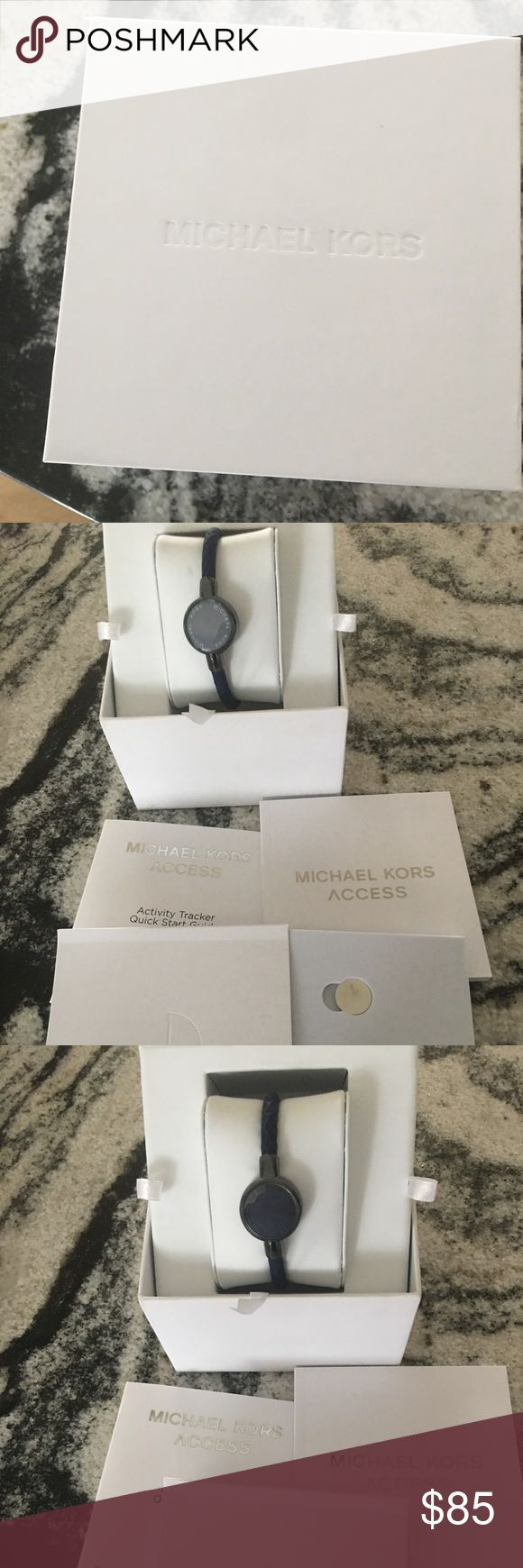 Michael Kors Access Activity Tracker NWOT Navy blue band and Navy Blue Mother of Pearl top. Has battery and tool to open back to change battery. Has two booklets and the Battery kit. Michael Kors Jewelry Bracelets