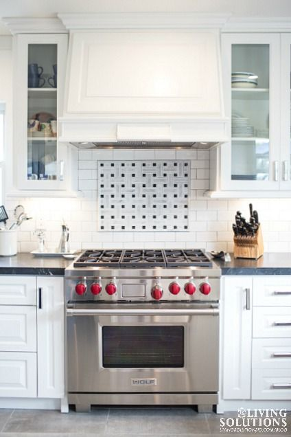 Wolf Range White Custom Hood and white and black marble basket weave backsplash. www.livingsolutionsid.com/blog