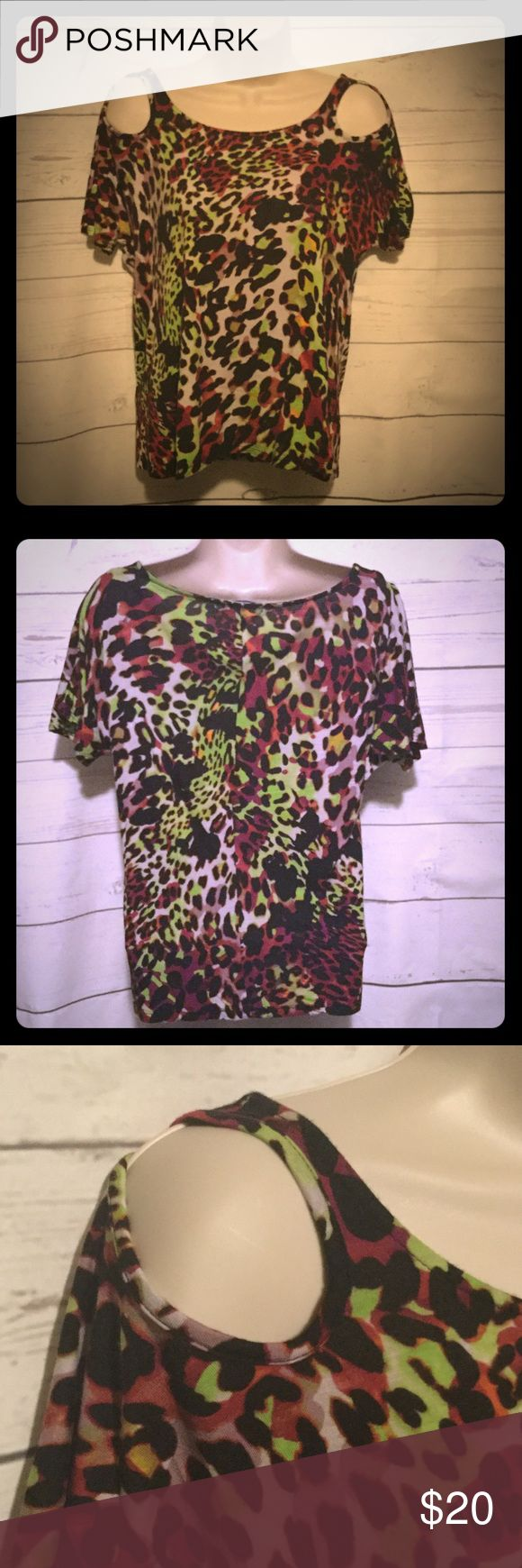 Leopard Tie Dye Open shoulder top NWOT The print is a neat purple, green, and black 'leopardy' tie dye. It is designed to sort of just hang on you. Looks great with cut off shorts or skinny jeans, never worn, just took the tags off, Charlotte Russe Tops Tees - Short Sleeve
