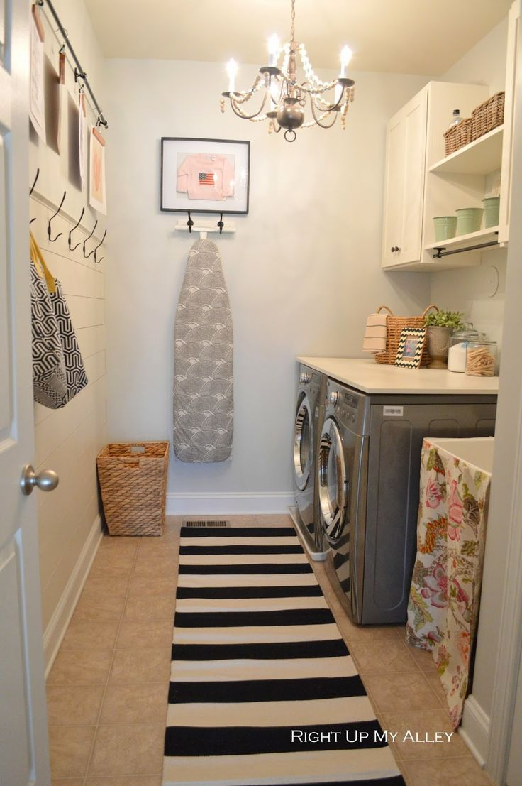 Laundry Room. Ikea patterned rug + hooks + cute bucket & basket organization.