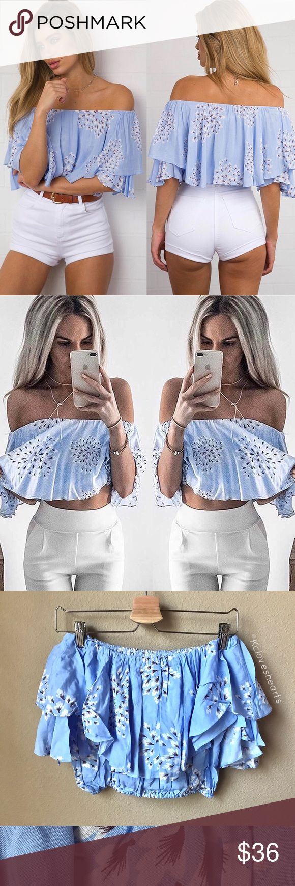 Blue Ruffle Off Shoulder Cropped Blouse In love with these cotton/polyester blend floral style print. Best fits someone who usually wears an xs/small. Pairs well with high waisted jeans and some wedges. Tops Crop Tops