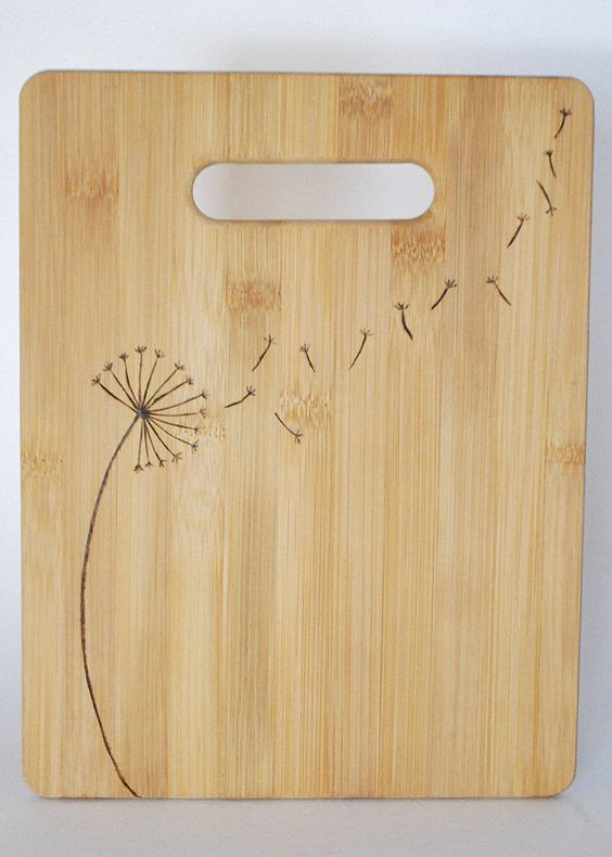 dandelion woodburned bamboo cutting board