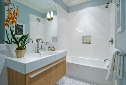 Vanity, love that it floats, large sink on top, hex tiles on floor, subway tiles on walls, large mirror