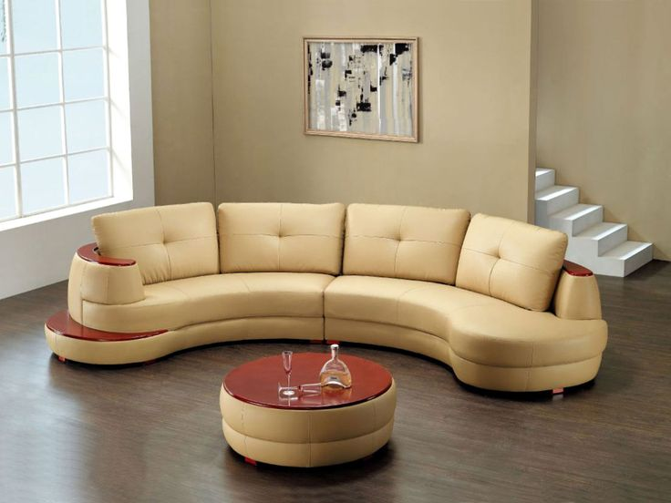 Living room sofa | leather curved sectional sofa with round coffee table and wooden floor for charming living room decoration | more inspiring images at http://diningandlivingroom.com/