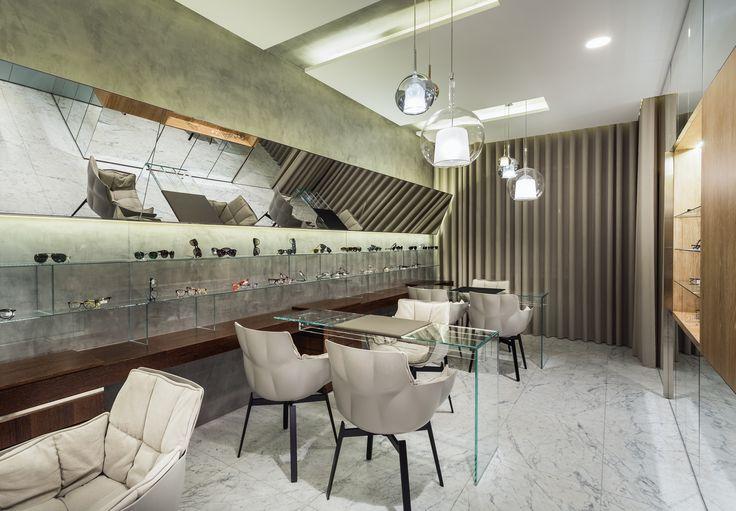 XYZ Arquitectos Associados - Óptica Moutinho - Porto - Portugal - interior design - optical store - Husk chair B&B Italia - Glo pendant light Penta Light