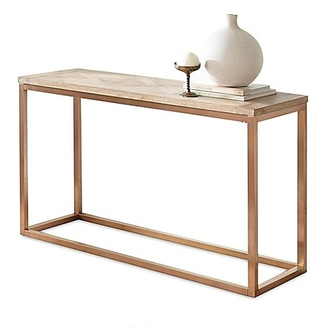 Rustic meets sophisticated in the Gino Wood Parquet Occasional Tables from Steve Silver Co. The parquet top of poplar veneers is unexpectedly paired with a rose gold finish base, a piece of designer chic for contemporary homes.