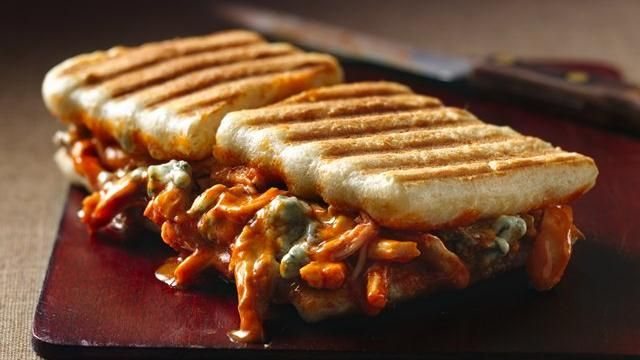 Buffalo chicken panini.  Super easy with already cooked shredded chicken.  Seems perfect for my pampered chef grill pan and press!