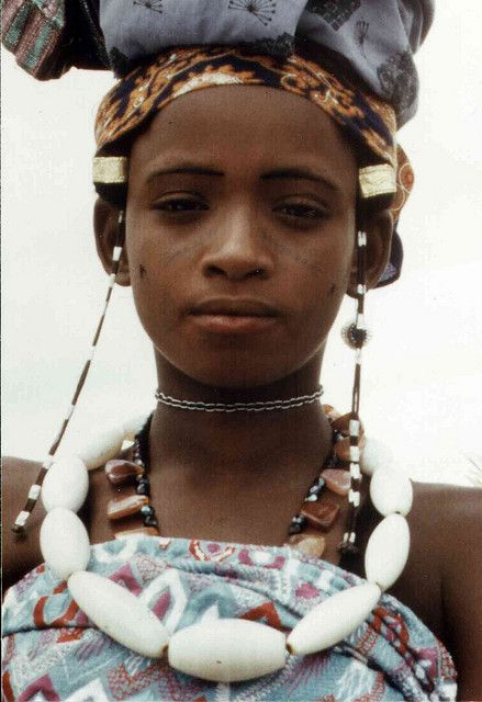 *|* This photo by Flickr user (Dogan56) entitled Ragazza Fulani, Nigeria is one of the few pictures that I have found that shows so beautifully an example of old Venetian 'Agate' glass beads from the African Trade. Venetians made these large glass beads to trade with the Yoruba. They're milky white, semi-translucent with veins & look like stone. If by chance they were stone, they would be white Indian Agate beads, which would also have come to Africa through the trade routes.