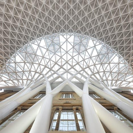 A semi-circular vaulted concourse designed by British architects John McAslan + Partners openD at King's Cross Station in London