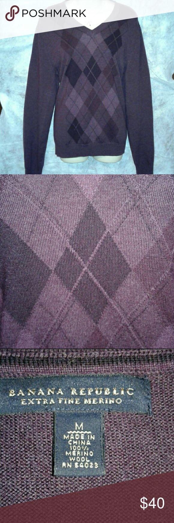 Banana republic merino Argyle sweater Beautiful plum colored Argyle sweater. 100% extra fine merino wool. So soft! Please note 2 small pills as pictured. Banana Republic Sweaters V-Necks