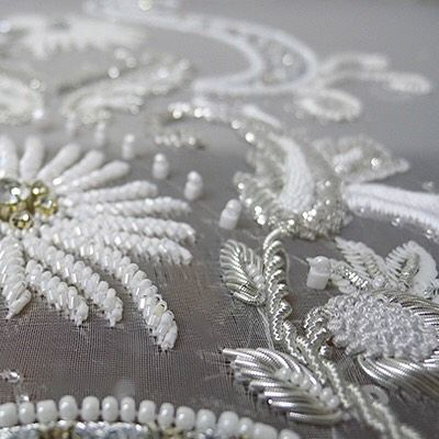 Subtle Saturday bridal beading close-up. White and silver glass beads and…