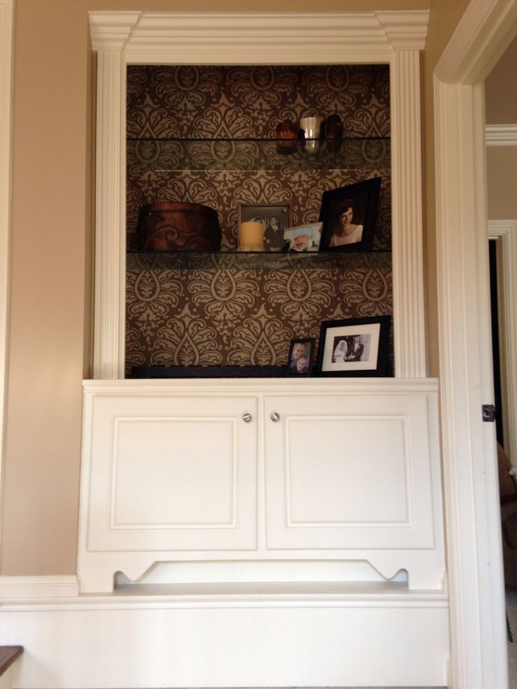 Material backed built ins. Dress up the normal white shelves with a pattern.. Anna Berry Design, LLC