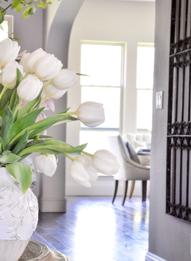 Beautiful spring tulips in entry hall