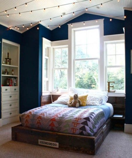 Christmas Lights in Bedroom 62 1 Kindesign 451x540 String Lights: 7 Fun Ways to Use Your Holiday Decor Year Round