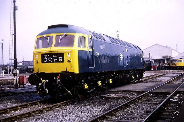 D1719 (later 47128, 47656, 47811) newly shopped at Crewe Works in readiness for hauling the Royal Train in connection with the Prince of Wales Investiture July 1969. Built at Brush Traction, Loughborough and delivered to Cardiff Canton on 25th Feb 1964. Named 'Firecrest' in May 1989 to May 1990 then 'United Transport Europe' on 5th July 1990. Still in service but stored at Crewe Basford Hall in Aug 2014. (John Turner)